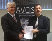 Car Trackers Navcis Head of Unit DCI Gordon Roberts Presents Automatrics National Police Partner Agreement to Automatrics MD Richard Taylor